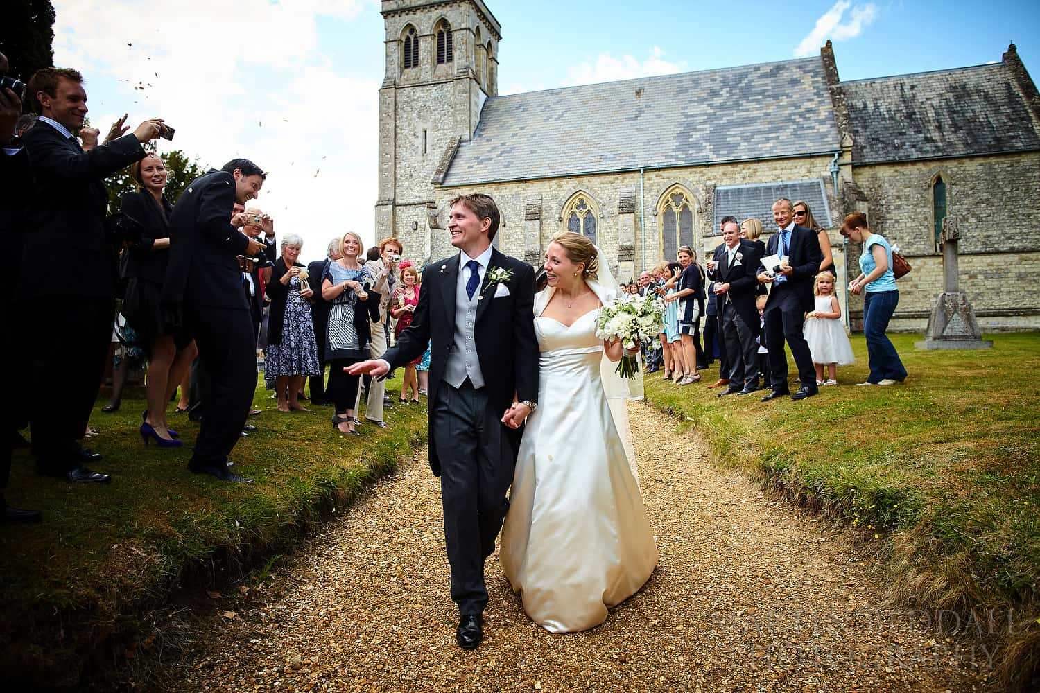 Bride and groom leave All Saint's church in Dogmersfield