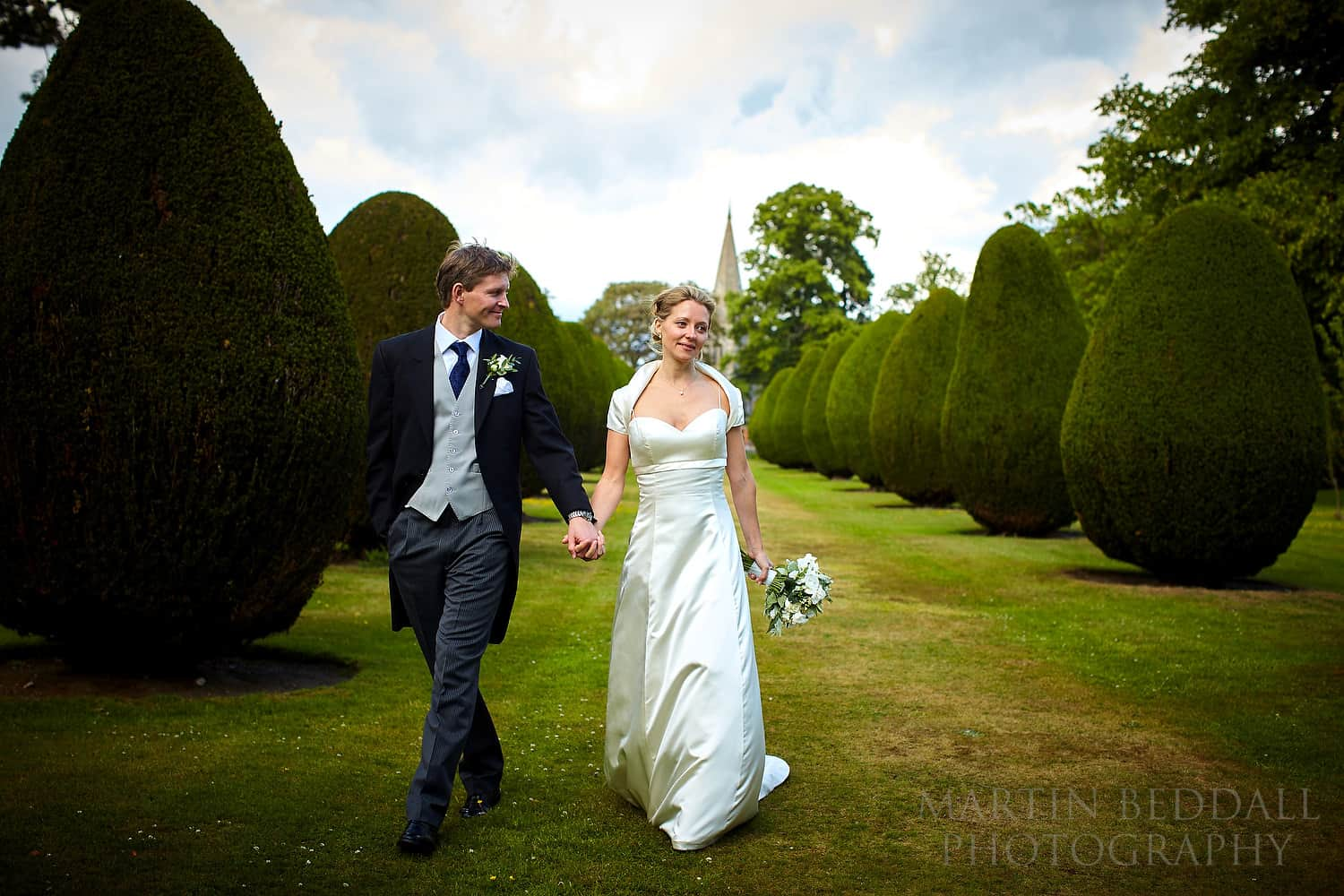 Bride and groom in the grounds of the Elvetham hotel