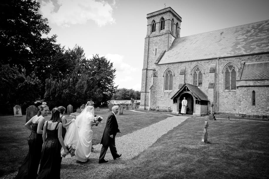 Bride walks towards Dogmersfield church