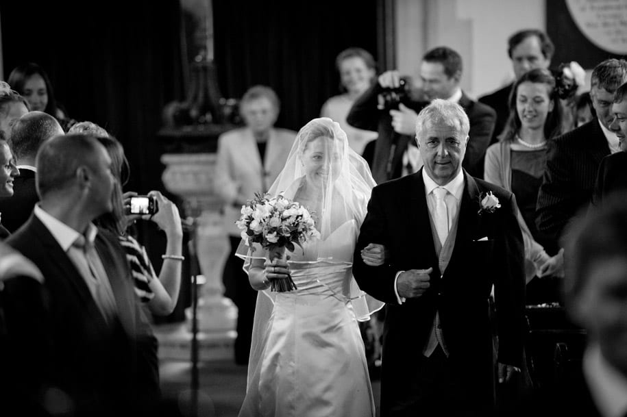 Bride walks down the aisle with her father at Dogmersfield church in hampshire