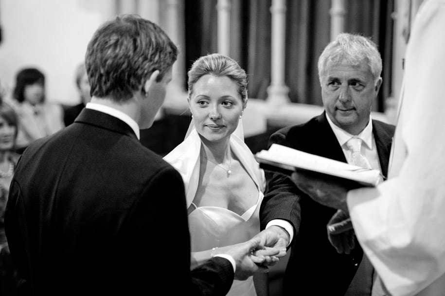 Bride's father hands her to the groom at the start of the wedding ceremony