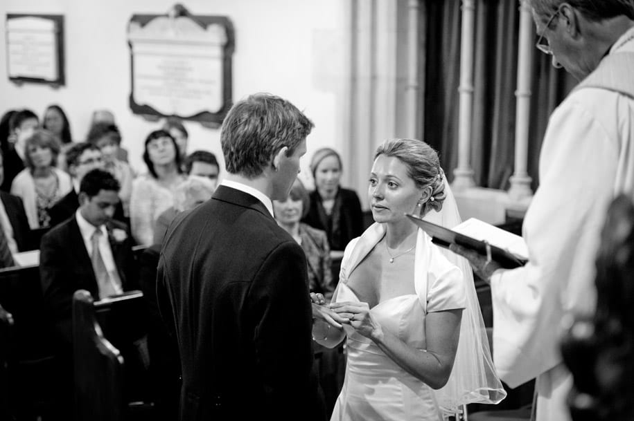 Bride puts the wedding ring on the groom's finger