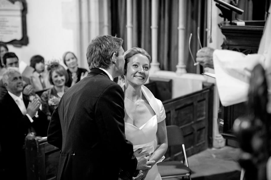 Groom kisses the bride after being declared married at Dogmersfield church
