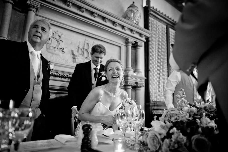 Bride laughs as she takes her seat at Elvetham hotel