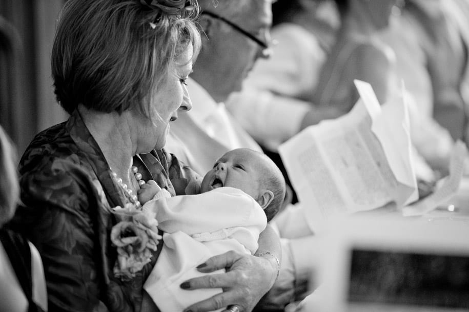 Bride's mother holds her grandchild during the speches