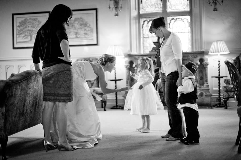 Bride says goodnight to the younger wedding guests
