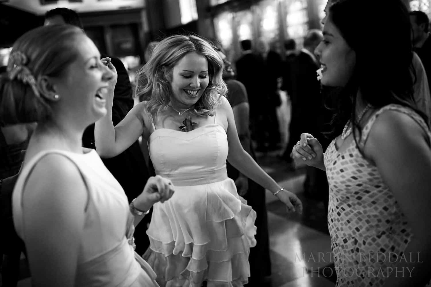 Bride dances with friends at Inner Temple wedding reception
