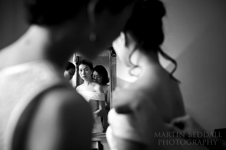 Bride getting ready at Ockenden Manor in West Sussex