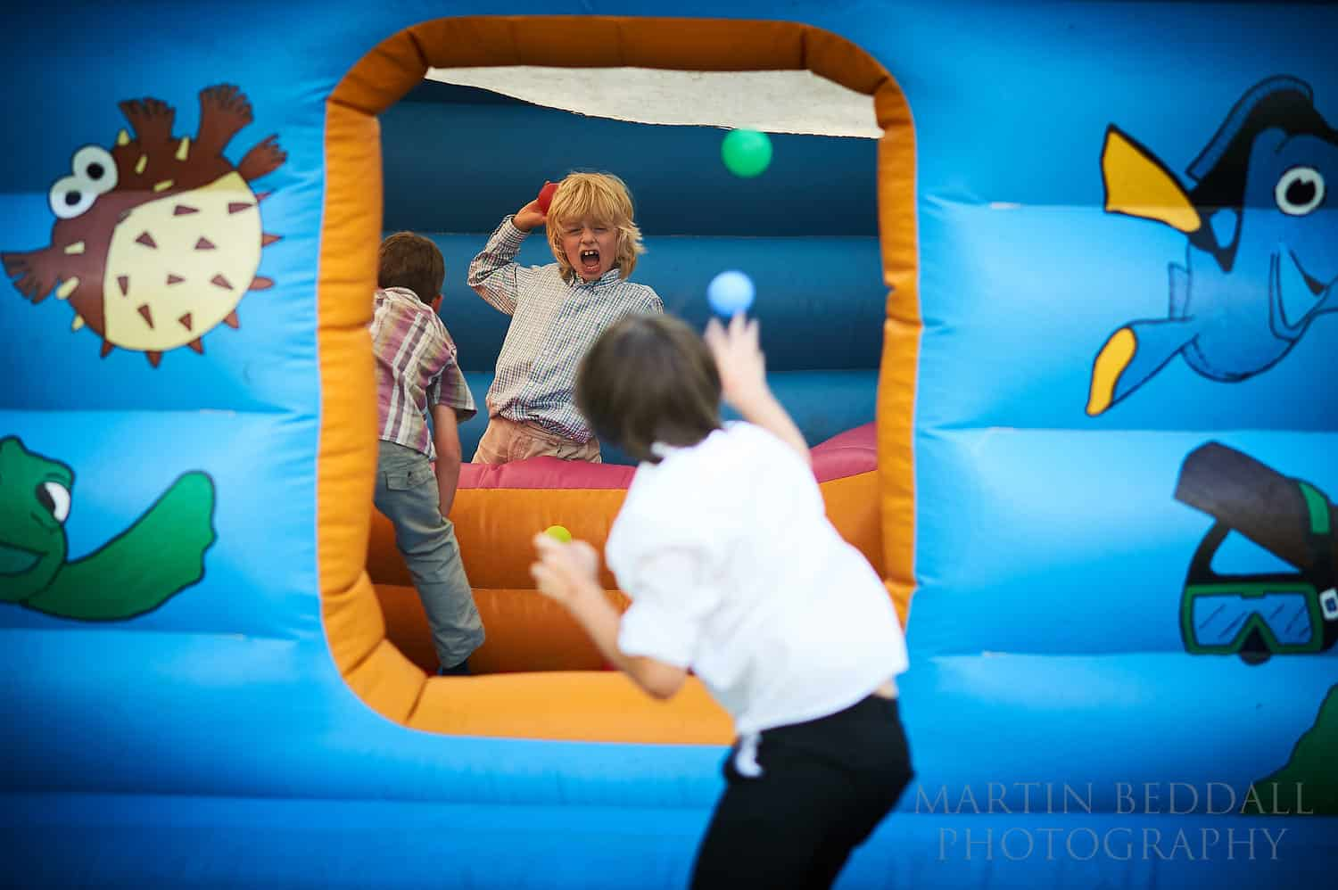 Kids play on the bouncy castle