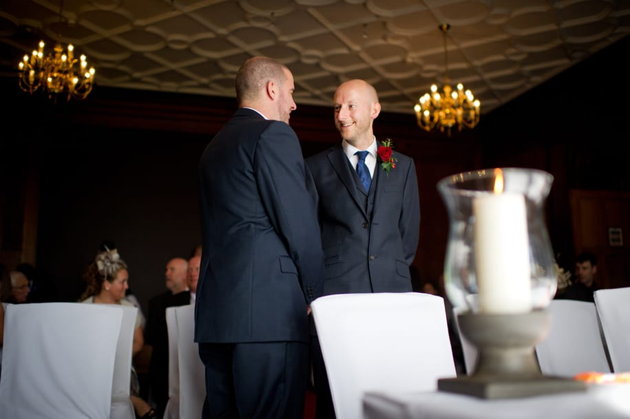 Groom shares a joke with best man