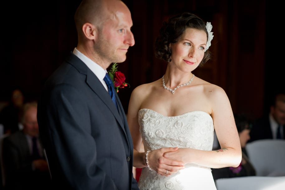 Bride and groom look to the registrar
