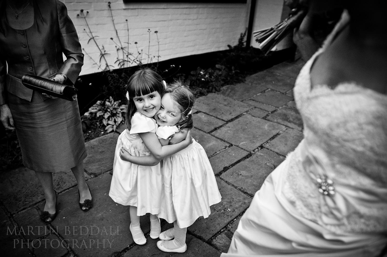 Hugging flower girls