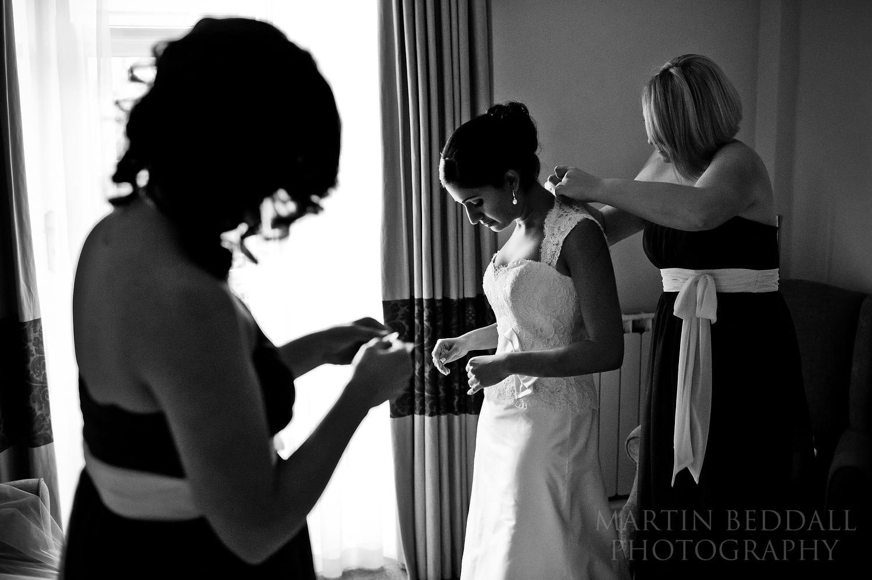 Bride getting ready at Burford Bridge Hotel wedding photograpjhy in 2011