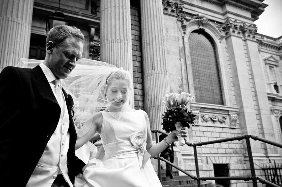 Happy bride and groom exit St Paul's Cathedral