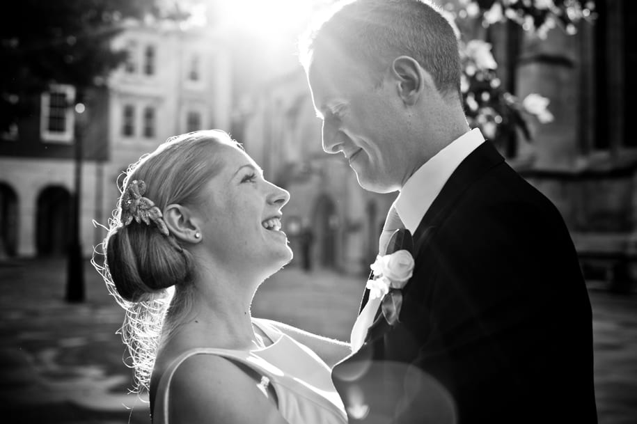 Bride and groom in the sunlight outside Temple church in London