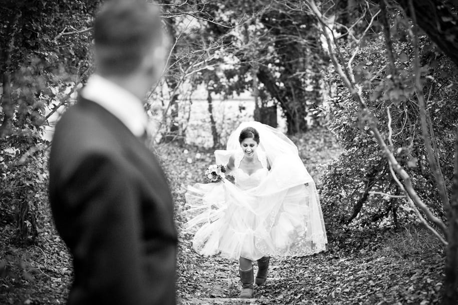 Bride walks up hill near Burford Bridge hotel
