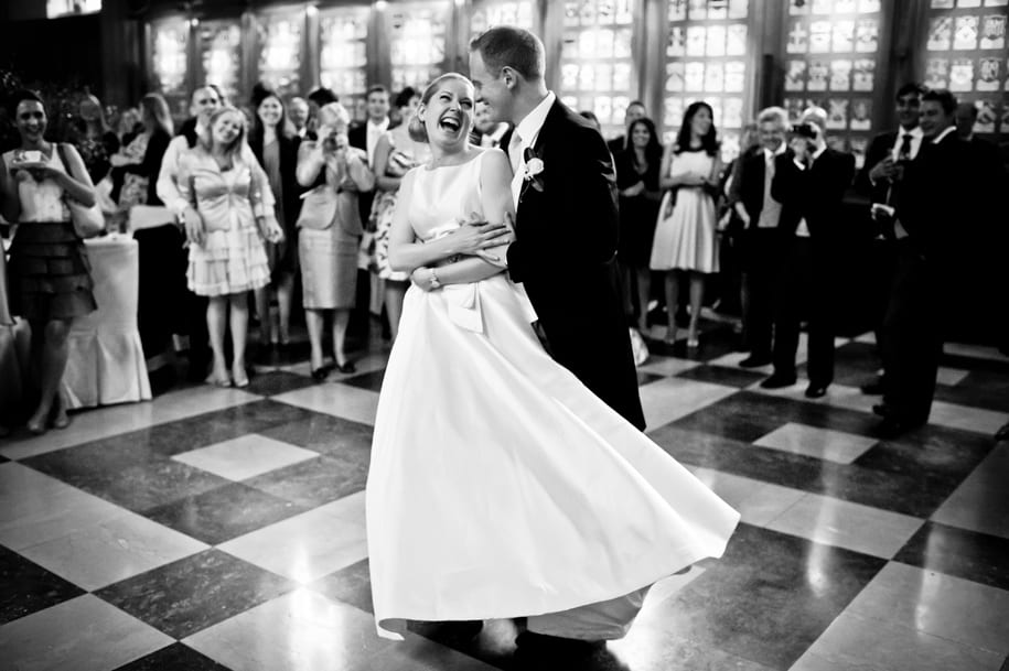 Bride and groom laugh during their first dance at Middle Temple Hall