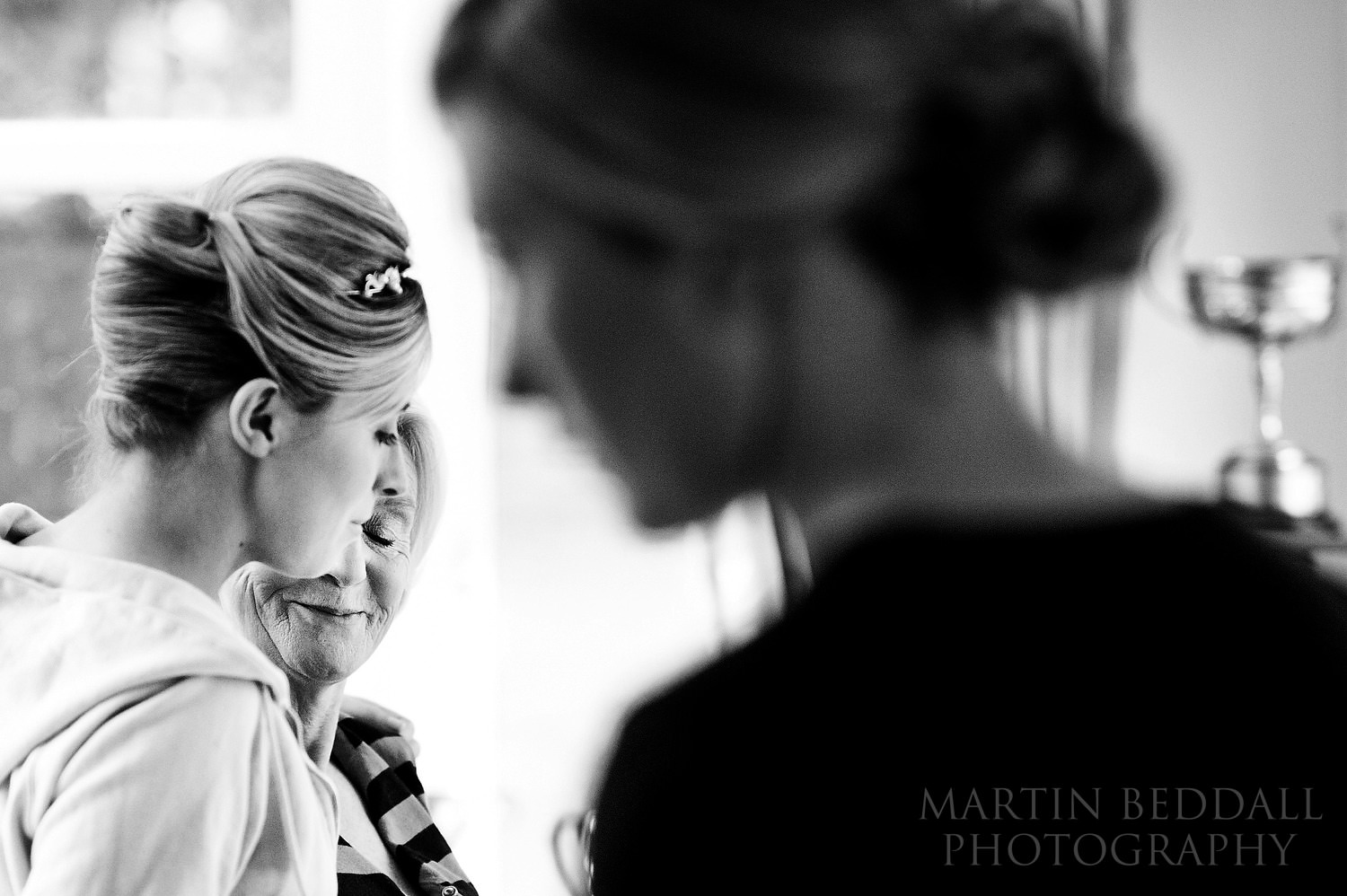 Bride hugs her mother during getting ready at Kent wedding