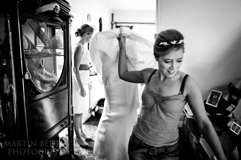 Bride grabs her wedding dress