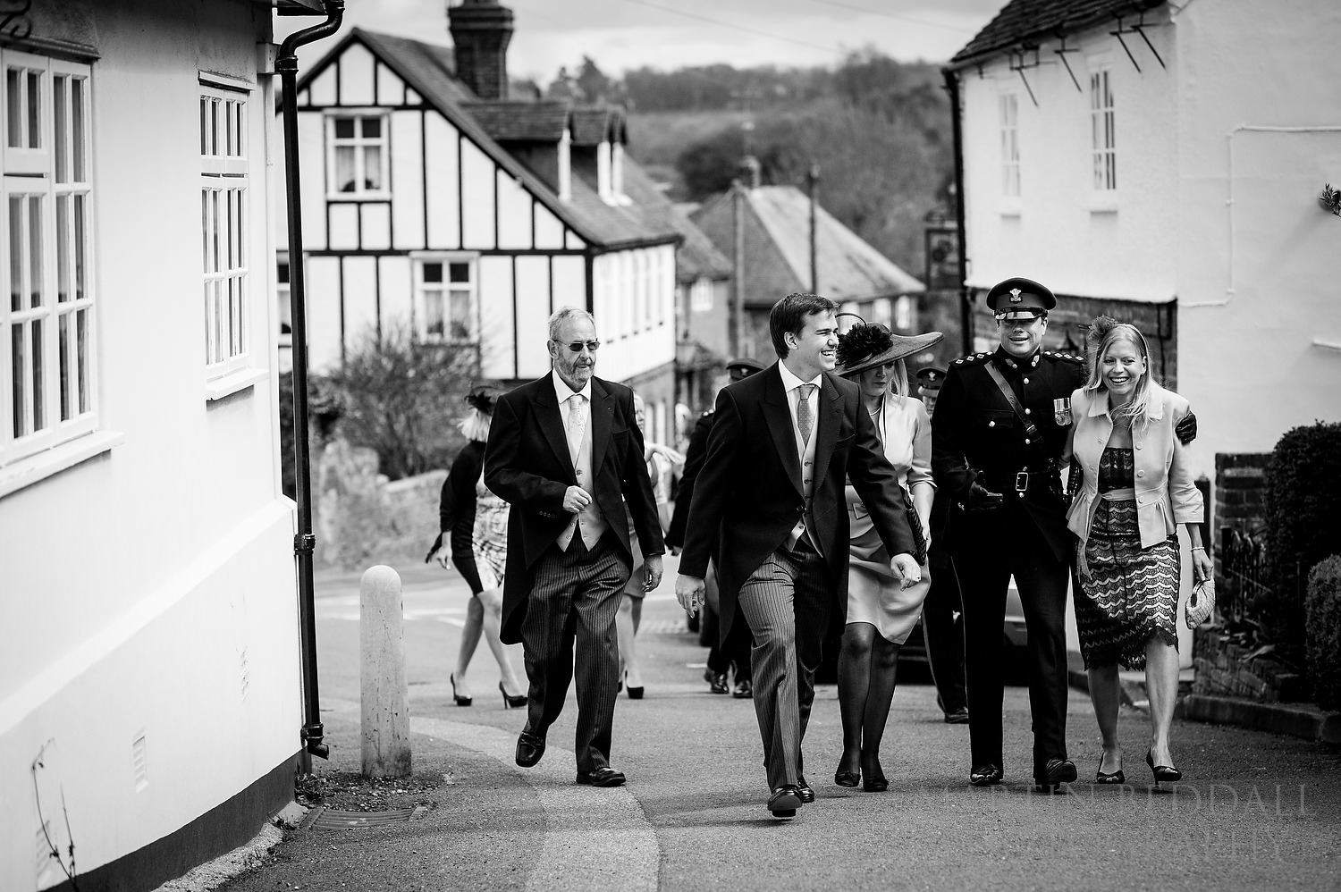 Wedding guests head to the church in the village of Shorne