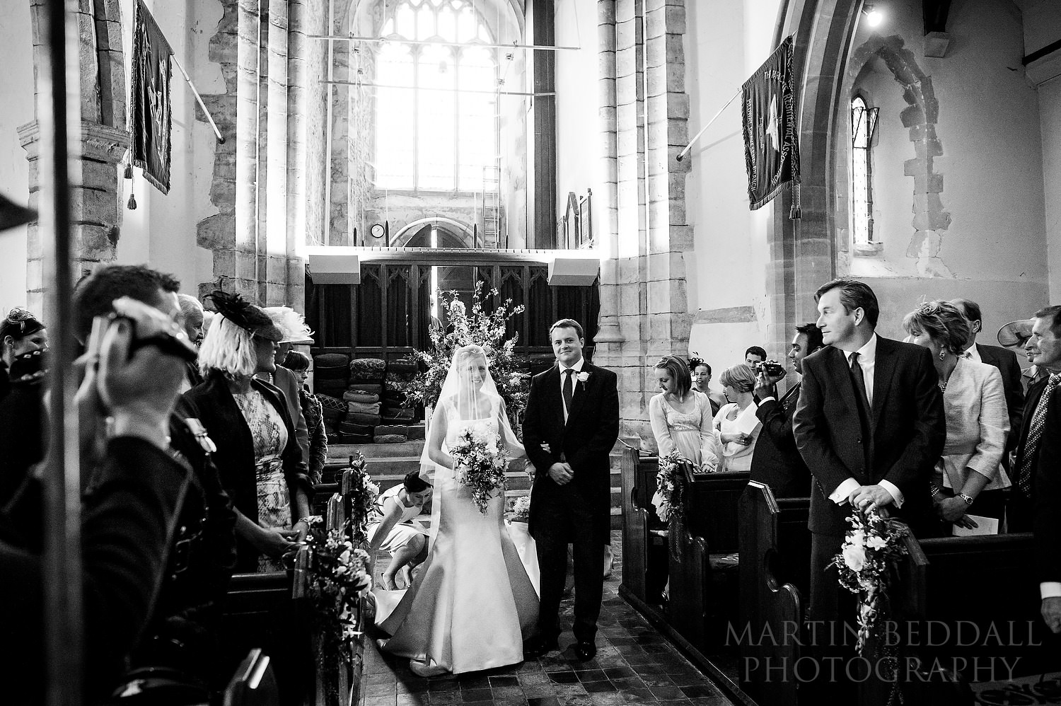 Bride in the church aisle with her brother