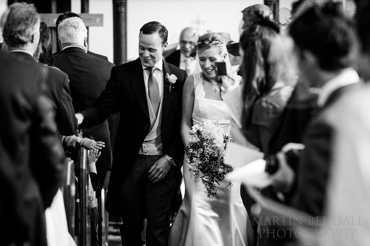 Bride and groom in the church aisle