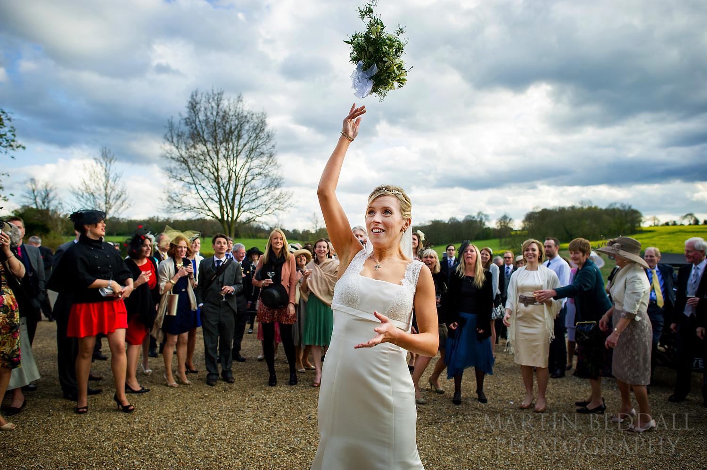 Bride throws the wedding bouquet