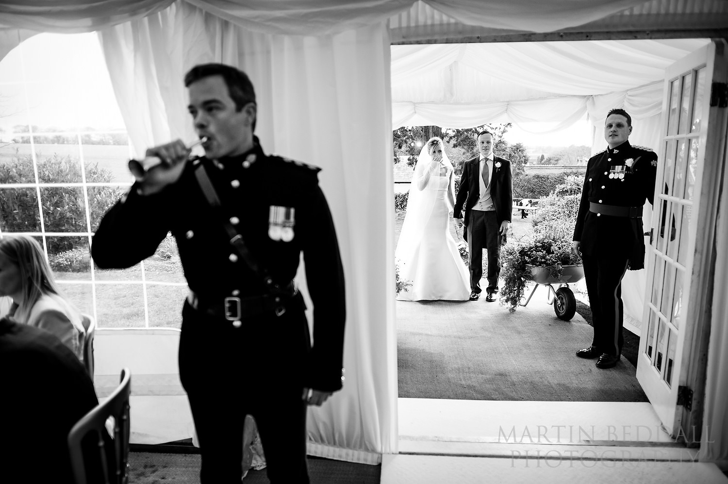 Bride asnd groom announced into dinner by military bugle