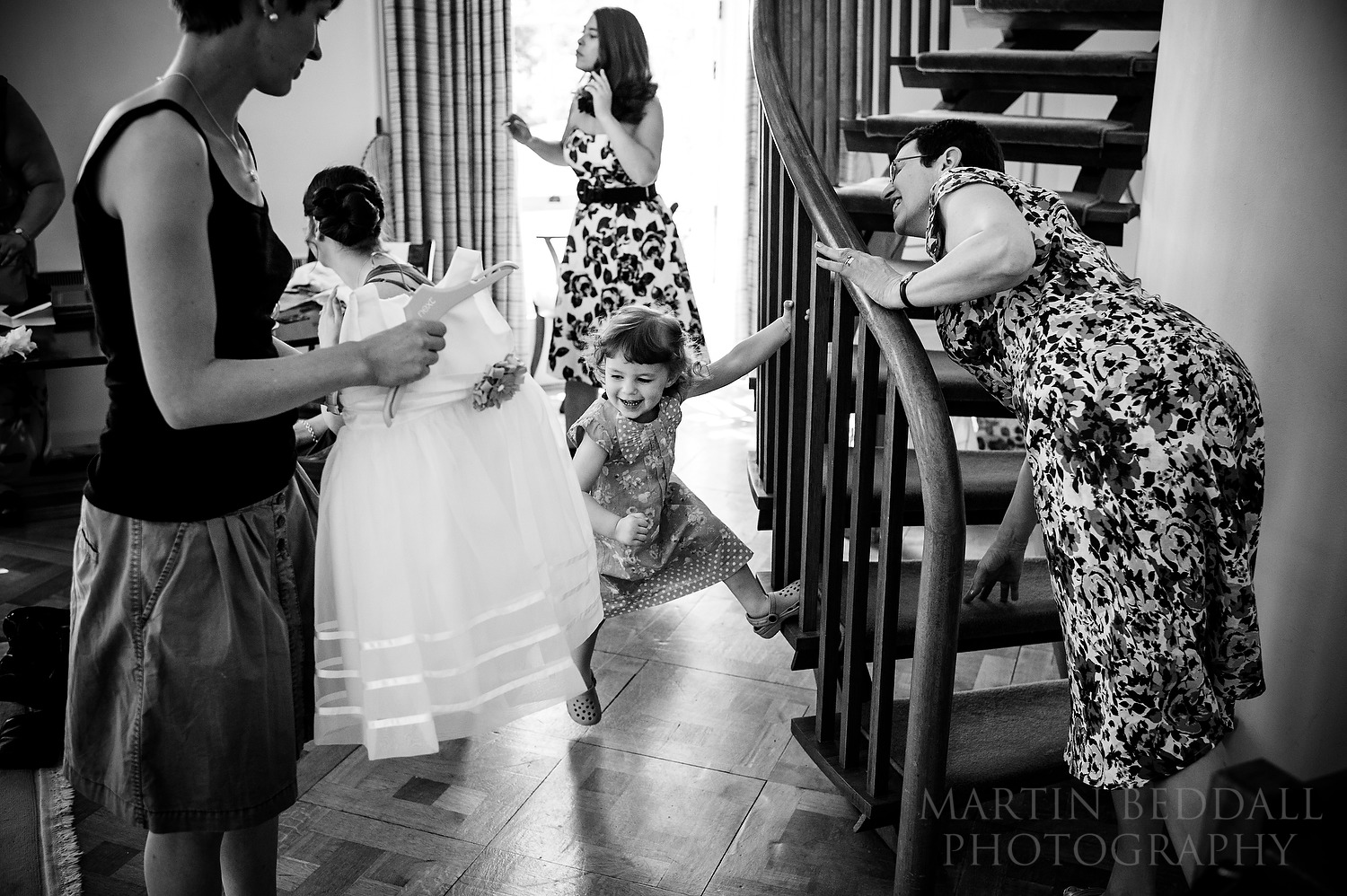 Getting flower girl into her dress