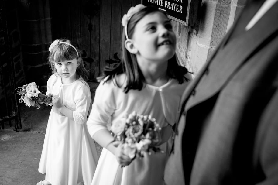 Young bridesmaids wait for the bride at St Mary's church in Horsham