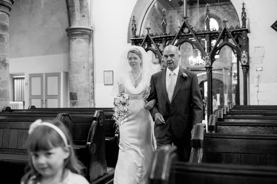 Bride enters St Mary's church in Horsham West Sussex
