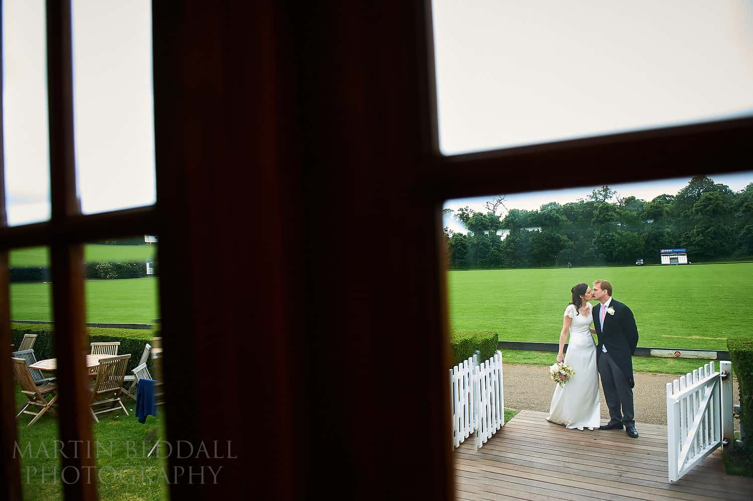 Bride and groom await to come into dinner at Ham polo club
