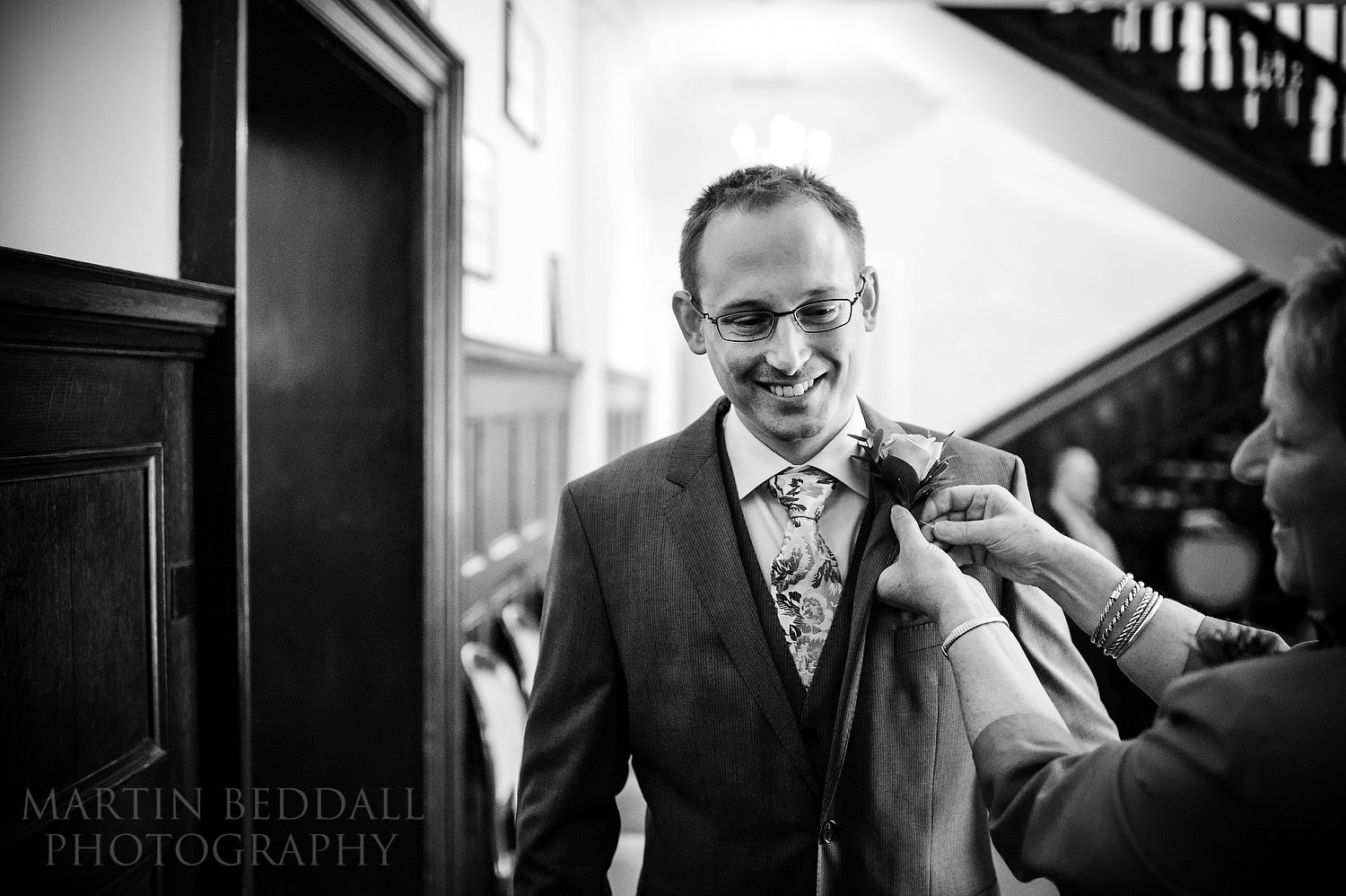Groom gets his buttonhole at Leatherhead Registry office