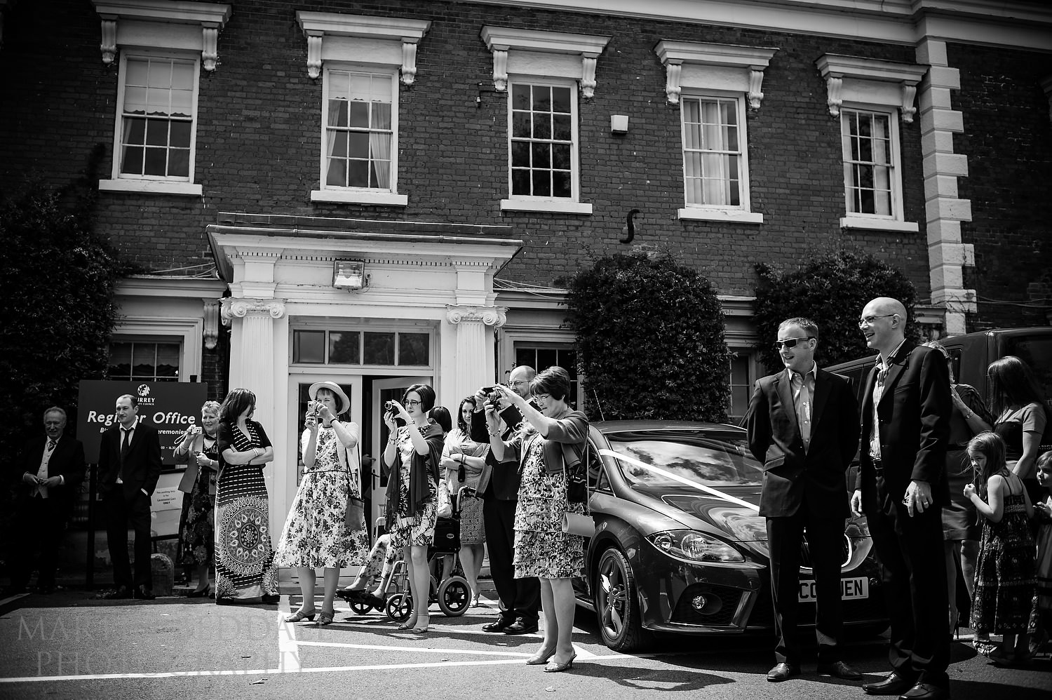 Guests watch the bride arrive