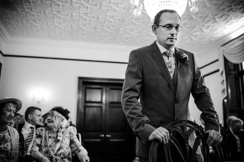 Nervous groom waits