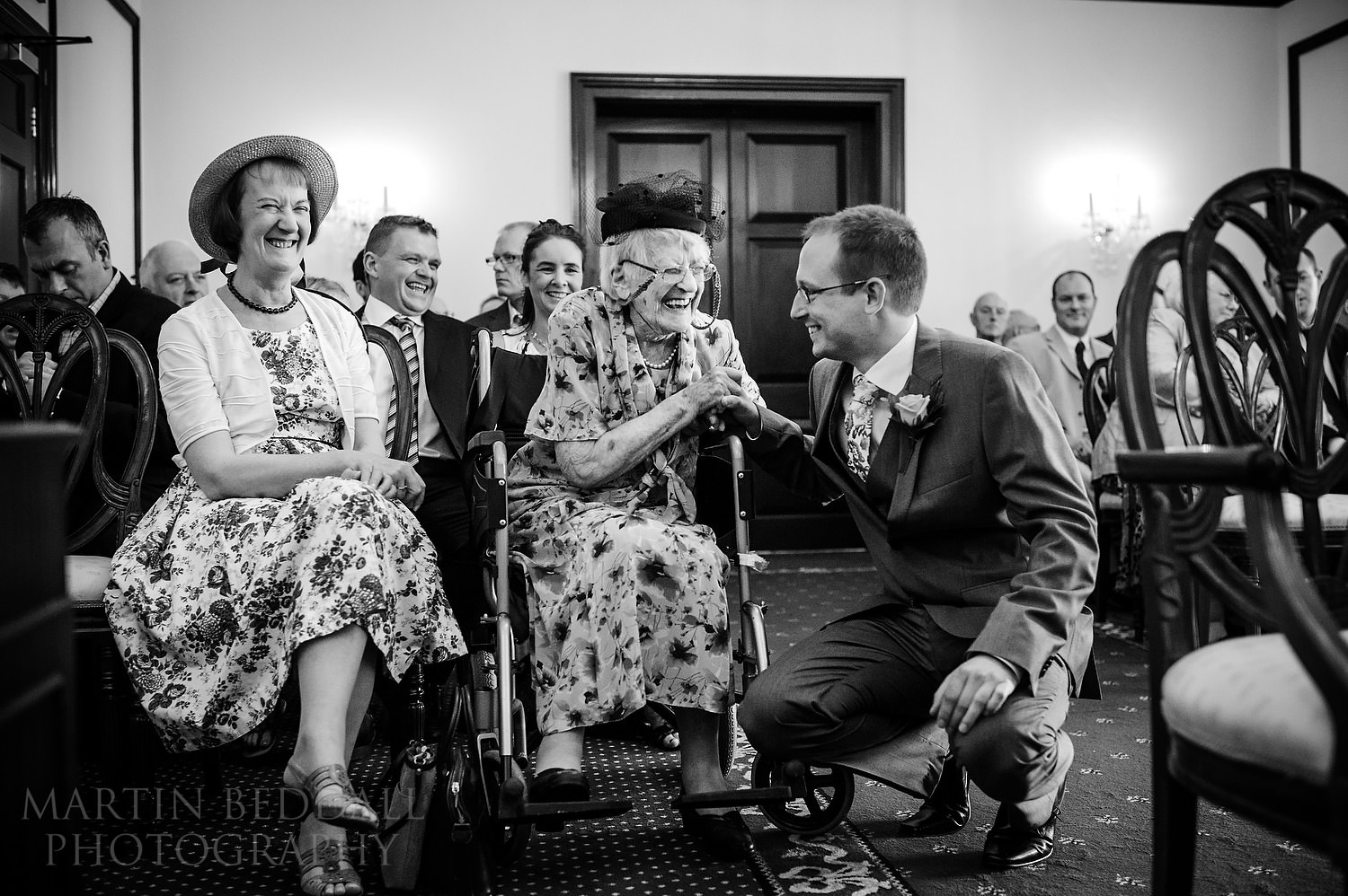 Groom jokes with old relative