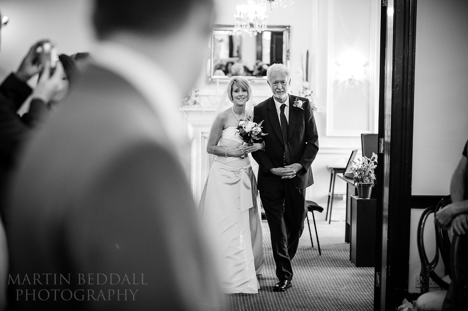 Bride enters the wedding ceremony room at The Mansion Leatherhead