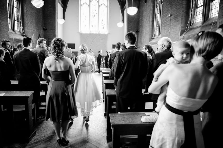 Bride walking down the aisle of the chapel