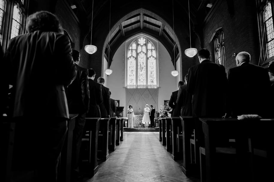 Singing hymns at Girton College chapel wedding