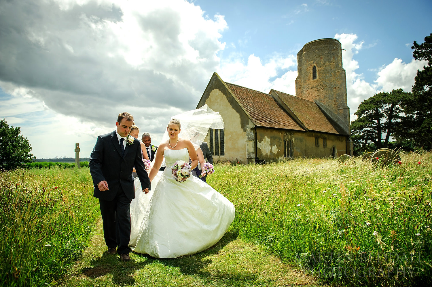 Bride and groom leave the church