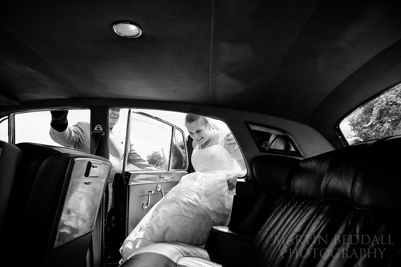 Getting into the wedding car