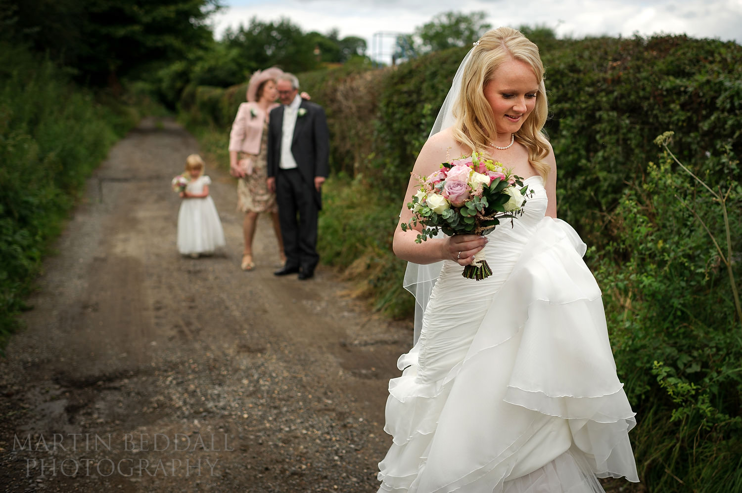Bride heading to the ceremony at Gate Street Barn wedding