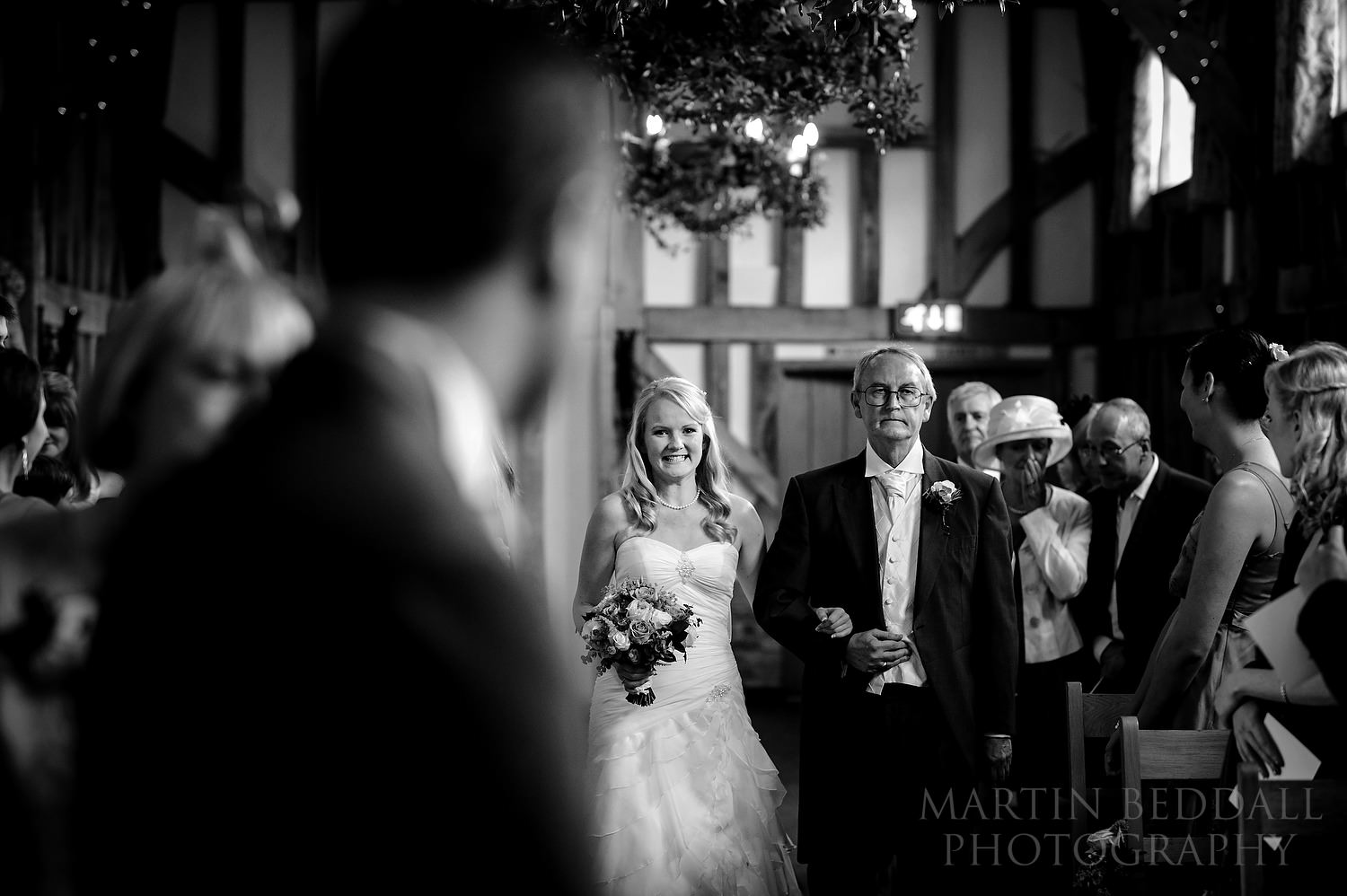Bride and her father walk down the aisle at Gate Street Barn wedding