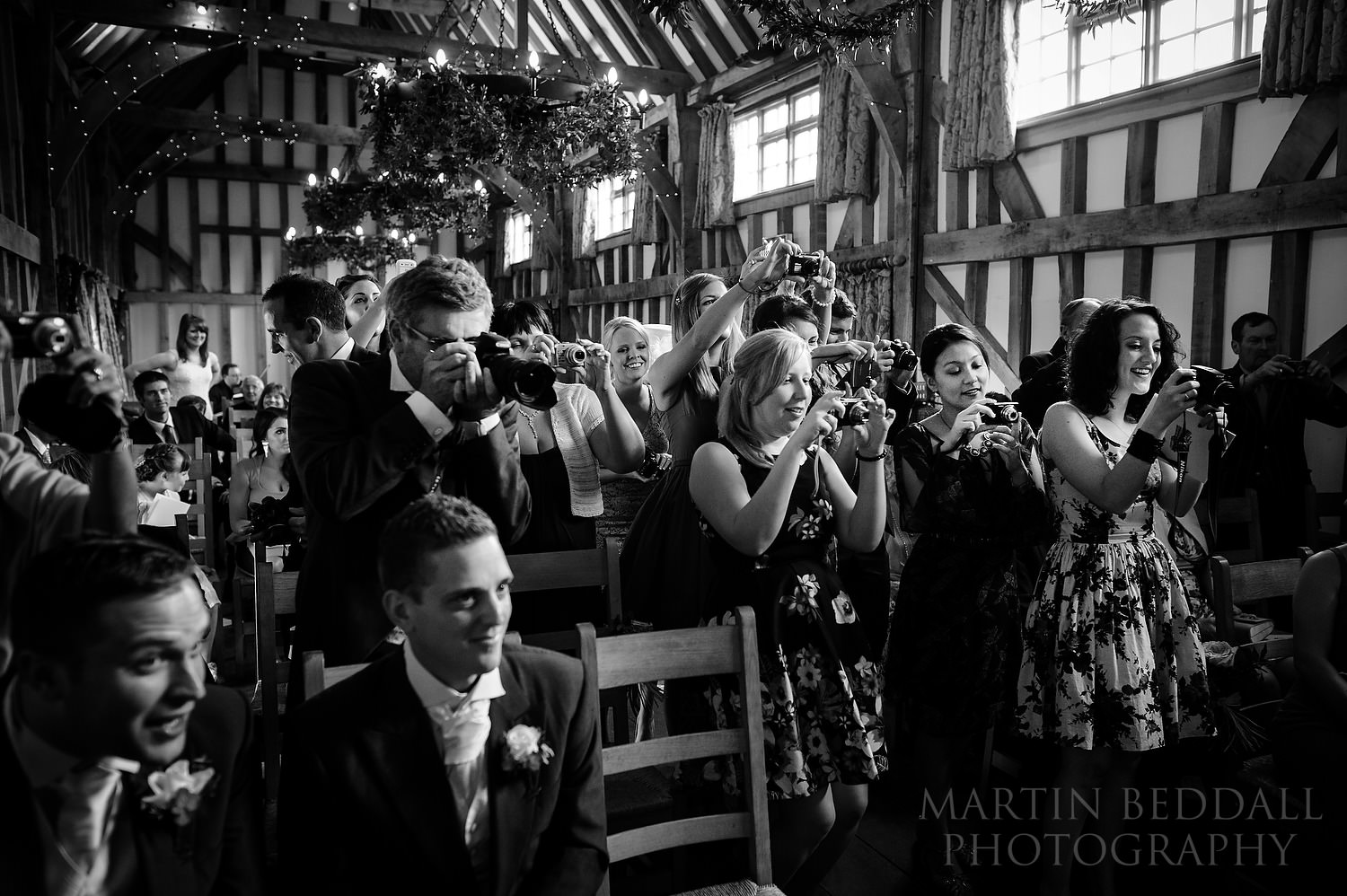 Guests photographing the couple at Gate Street Barn wedding