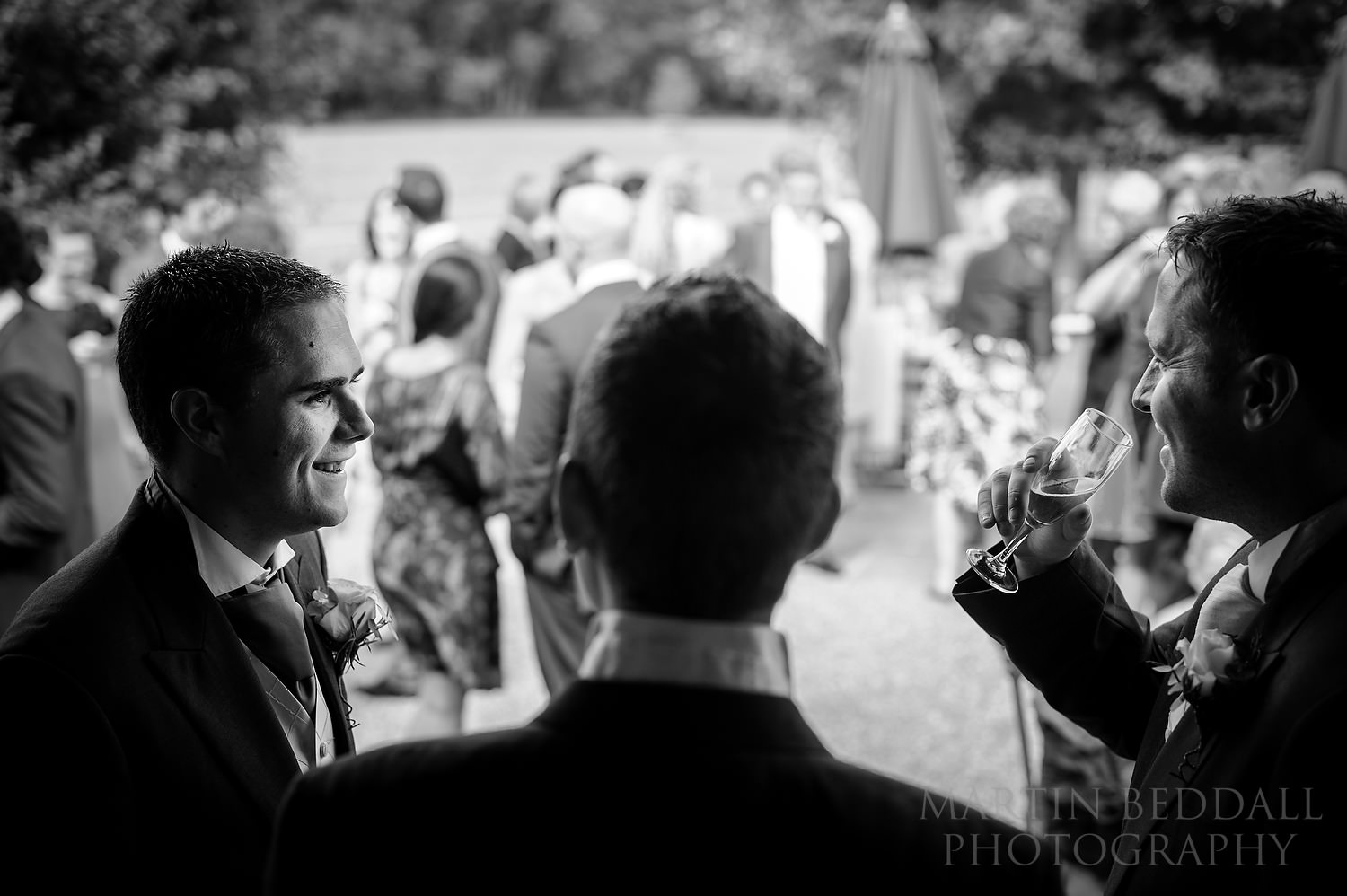 Groom chats with friends