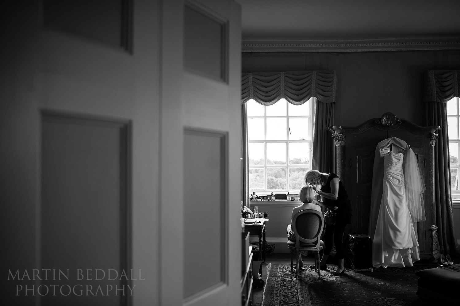 Bride getting ready in a room at Kirtlington Park