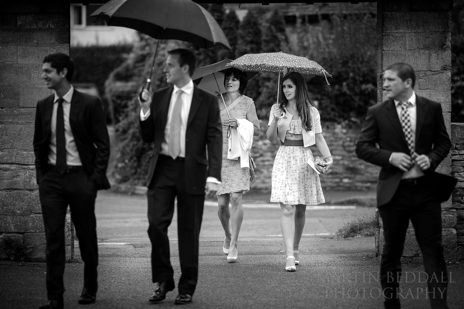 Wedding guests arrive in the drizzle