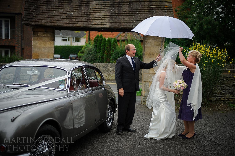 Bride's mother adjusts her veil
