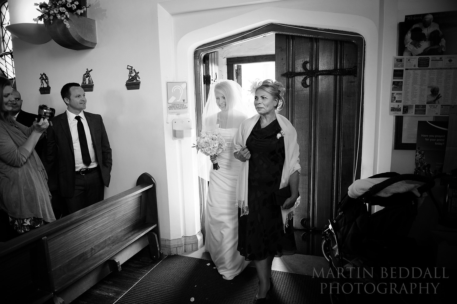 Bride enters the church with her mother