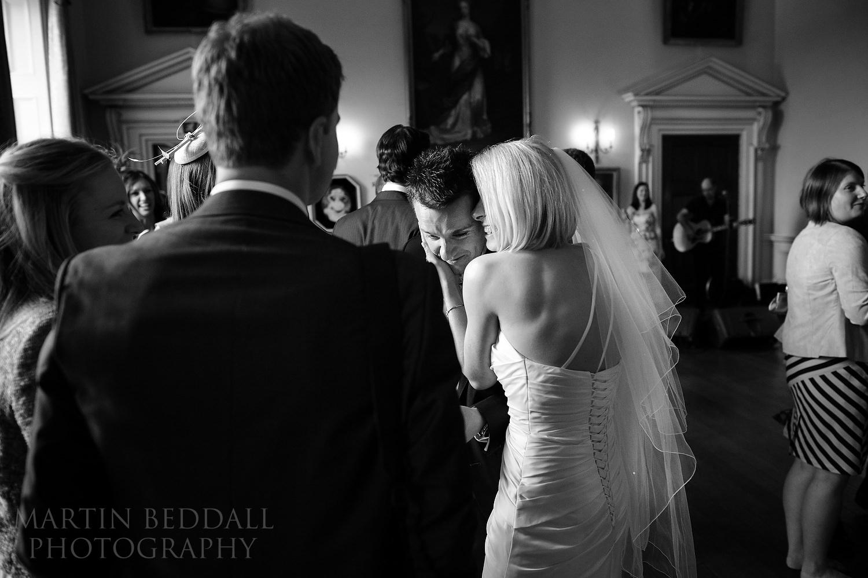 Bride and groom hug at Kirtlington Park wedding